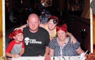 Adams Family dining on Disney Fantasy during Pirate Night