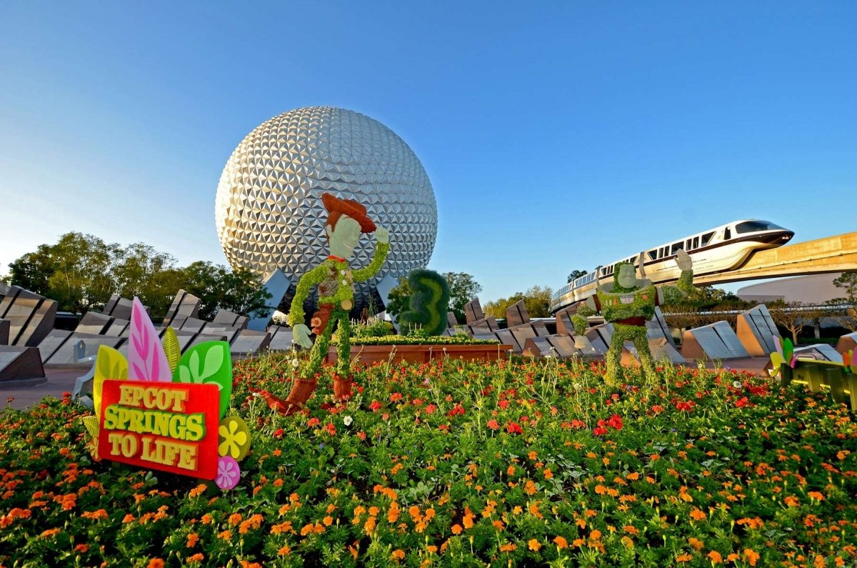 EPCOT spring flowers with Mission Earth and Monorail in background