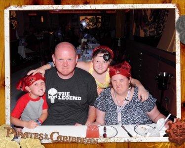 Adams Family dining on Disney Fantasy during Pirate Night